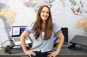 Megan Avard against a world map